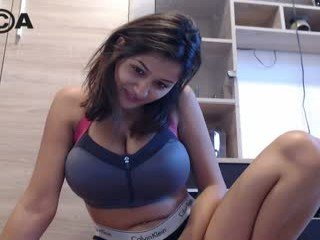 Webcam Belle - teddyfleece brunette cam girl with big tits gets her pussy fucked from behind